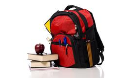 red school back pack with books - stock photo