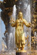 girl with a fountain of friendship  turkmenistan - stock photo