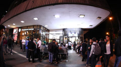 Sao Paulo Brazil night life: people sit in restaurant after hours Stock Footage