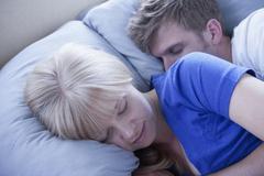 Close up of sleeping couple Stock Photos