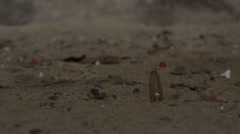 Ammunition - Empty Bullet Casings Hit Dirty Ground Stock Footage