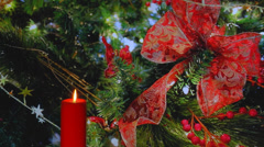Red candle with red ribbon bow in background Stock Footage