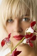 Red lips and flower Stock Photos