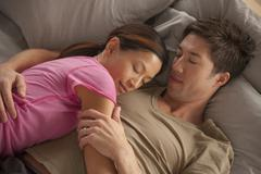 Elevated view of couple sleeping Stock Photos