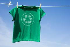 Green t-shirt with recycle symbol Stock Photos