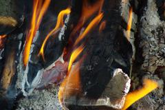 Closeup of firewood burning in fire Stock Photos