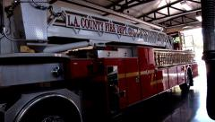 angeles county fire department ladder truck parked in fire station fire truck - stock footage
