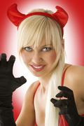 portrait of blond devil - stock photo