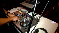 DJ disk jockey mixing board playing music people dancing party club fun mixing  Stock Footage