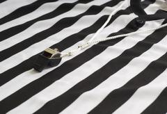 referee shirt with whistle - stock photo