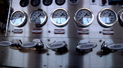 fire truck water pump panel gauges cutaway transition closeup firefighter - stock footage