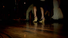 Club people dancing on a hardwood flooring party fun happy cutaway transition Stock Footage