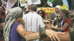 American reaction to Syria - Angry protesters clash - stock footage