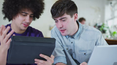 Young male students working together with technology Stock Footage