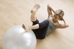 Woman exercising with fitness ball Stock Photos