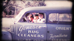 Mom drives the family business vehicle, panel van, 122 vintage film home movie Stock Footage
