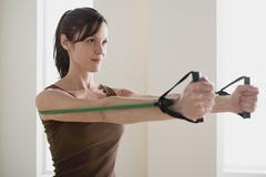 Woman exercising with resistance band Stock Photos