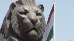 Lion statue and national flag Tajikistan Stock Footage