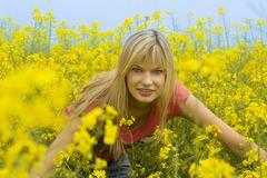 happy girl in yellow field - stock photo
