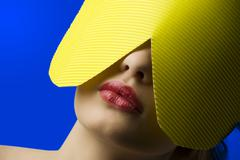 yellow paper mask - stock photo