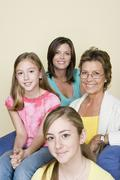 Portrait of three generation family with two girls (8-9, 14-15) Stock Photos
