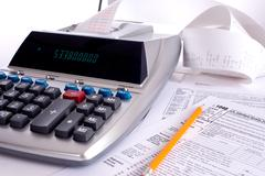 Adding machine with tax forms Stock Photos