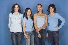 Portrait of four mid adult women including twins - stock photo