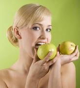 Biting apple Stock Photos