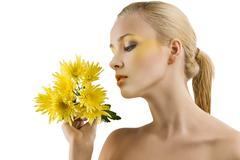 Profile girl with yellow flower Stock Photos