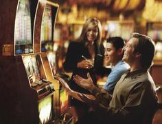 People in casino playing on slot machines, Las Vegas, Nevada, USA - stock photo