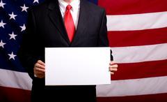 Politician holding blank sign Stock Photos