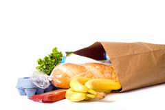 Bag of groceries on white Stock Photos