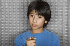 Studio portrait of young man pointing at camera Stock Photos