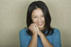 Studio portrait of mid adult woman smiling - stock photo