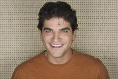 Stock Photo of Studio portrait of mid adult man smiling