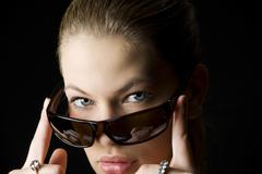 looking behind sunglasses - stock photo