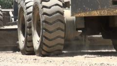 Wheels of a shovel, during road construction in Dushanbe - stock footage