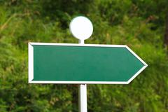 blank green sign with right direction - stock photo