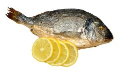 Oven Baked Sea Bream With Lemon Stock Photos