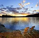 Stock Photo of Canada, Ontario, Algonquin Park, Adirondack chairs on edge of lake