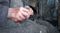 Hands of a shoemaker repairing small shoe Stock Footage