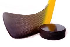 hockey stick and puck - stock photo