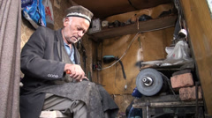 Small workshop of a shoemaker in Central Asia, poverty, traditional, small, work Stock Footage