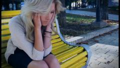 Crane shot of woman sits sad in depression crying, click for HD - stock footage