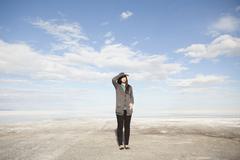 USA, Utah, Salt Lake City, Young woman standing on desert and looking away Kuvituskuvat