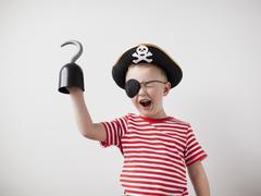 Toddler boy (2-3) dressed-up as pirate Stock Photos