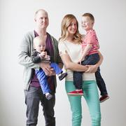 Portrait of happy young family with two boys (12-17 months, 2-3) Stock Photos