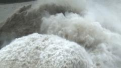 Flood Waters Cascade From Dam After Tropical Storm Stock Footage