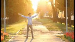 Man walks celebrates his victory, king of world, glorious moves, click for HD Stock Footage
