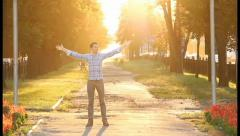 Test passed! Man enjoys himself in sunny park celebrates victory, click for HD Stock Footage
